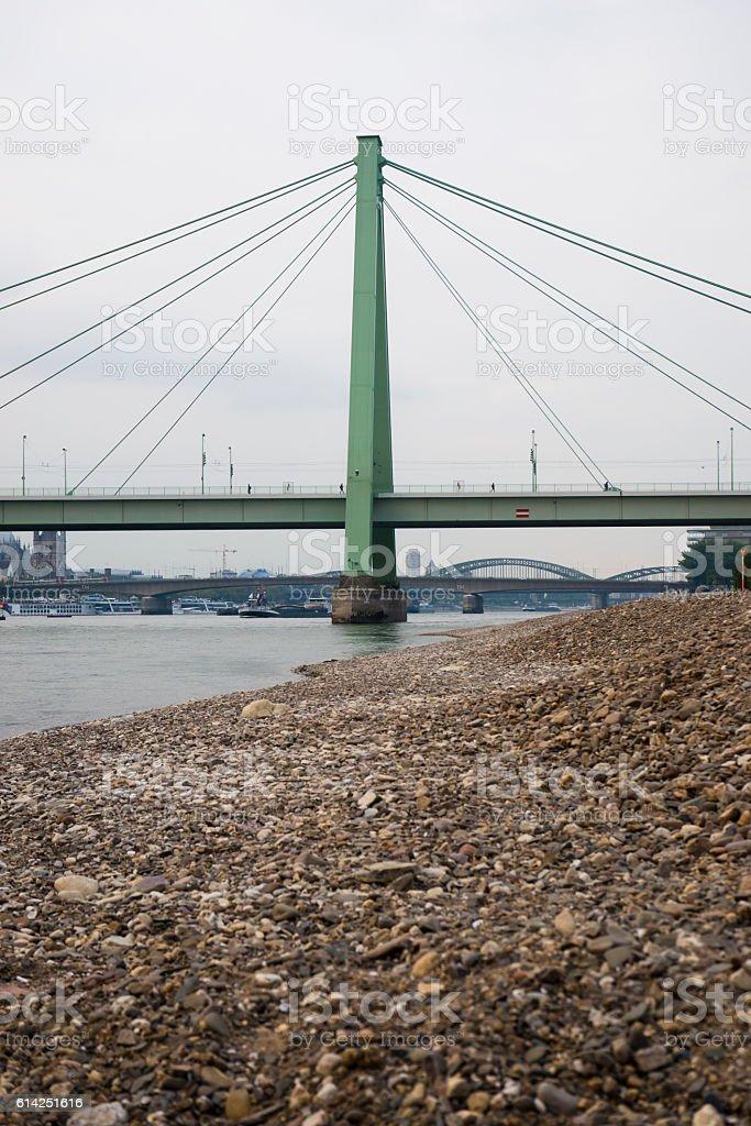 Beam bridge across rhine river in cologne stock photo