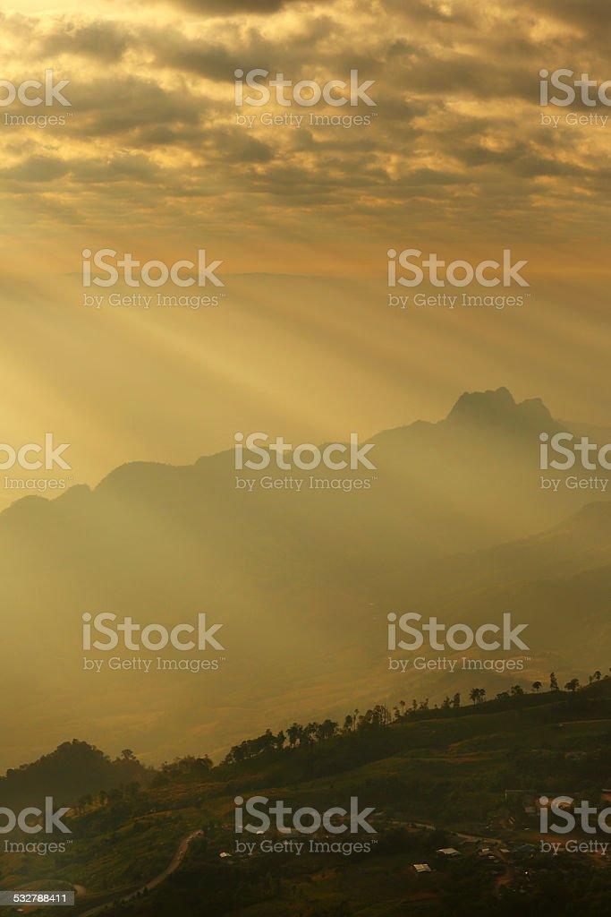 Beam light at the peak of mountain stock photo