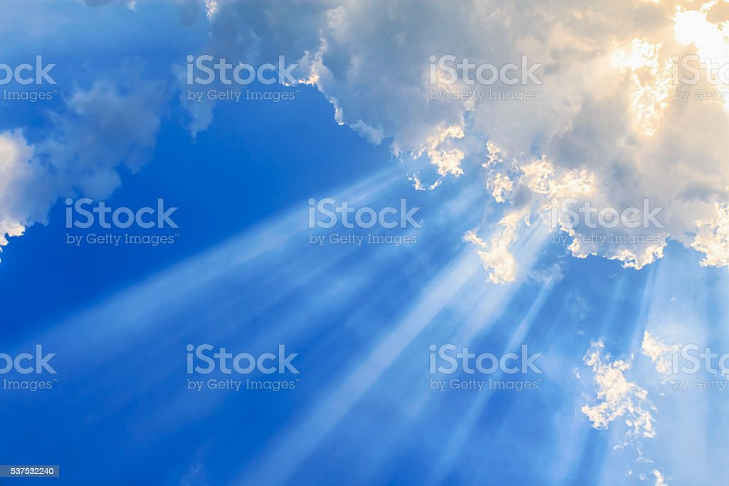 Beam of light and the clouds stock photo