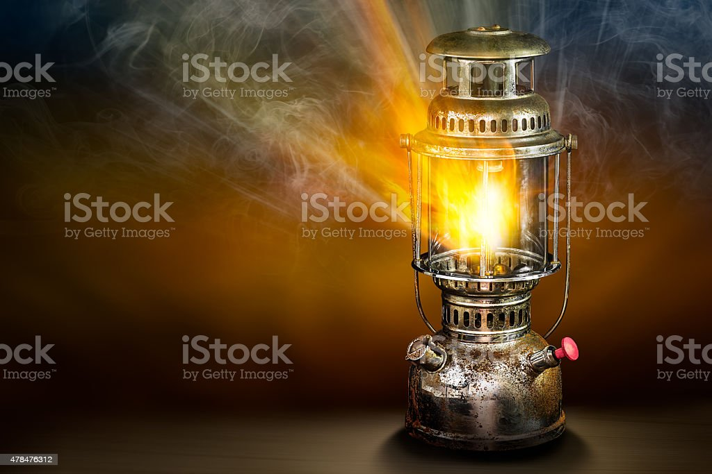 Beam of light from storm lantern stock photo