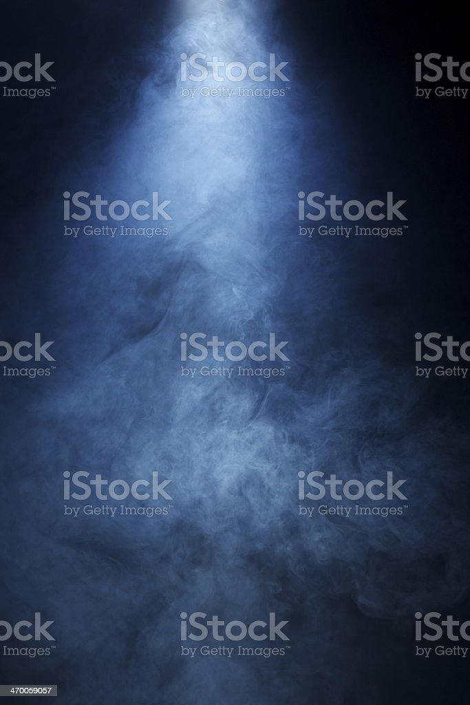 Beam of Light Passing Through Blue Smoke onBlack Background stock photo