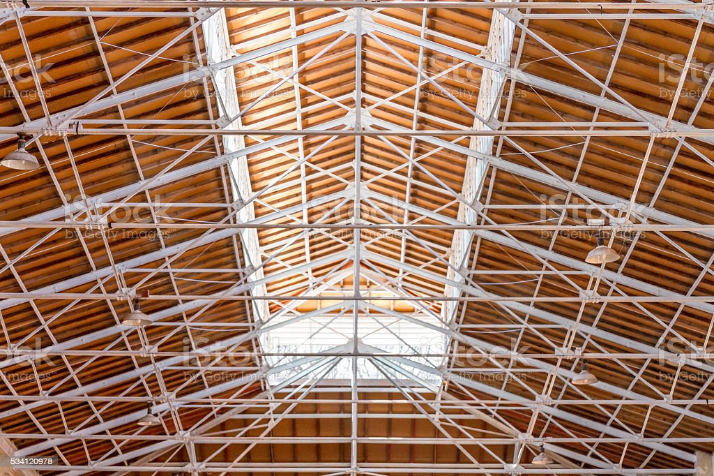 Beam structure of iron on a wooden ceiling with skylight stock photo