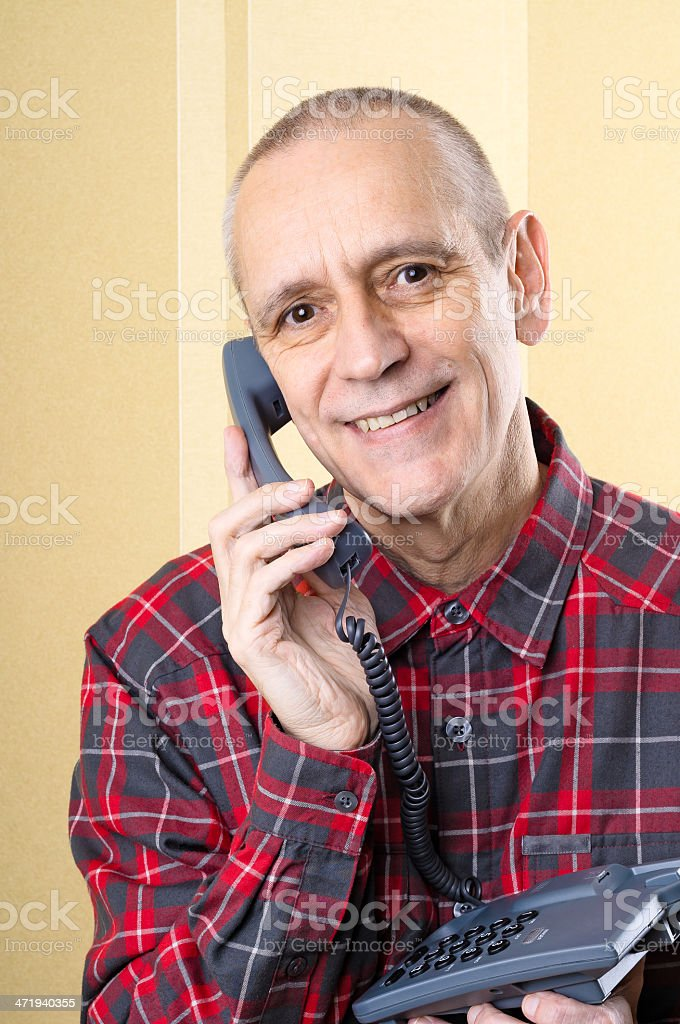 Beaming Man on Phone stock photo