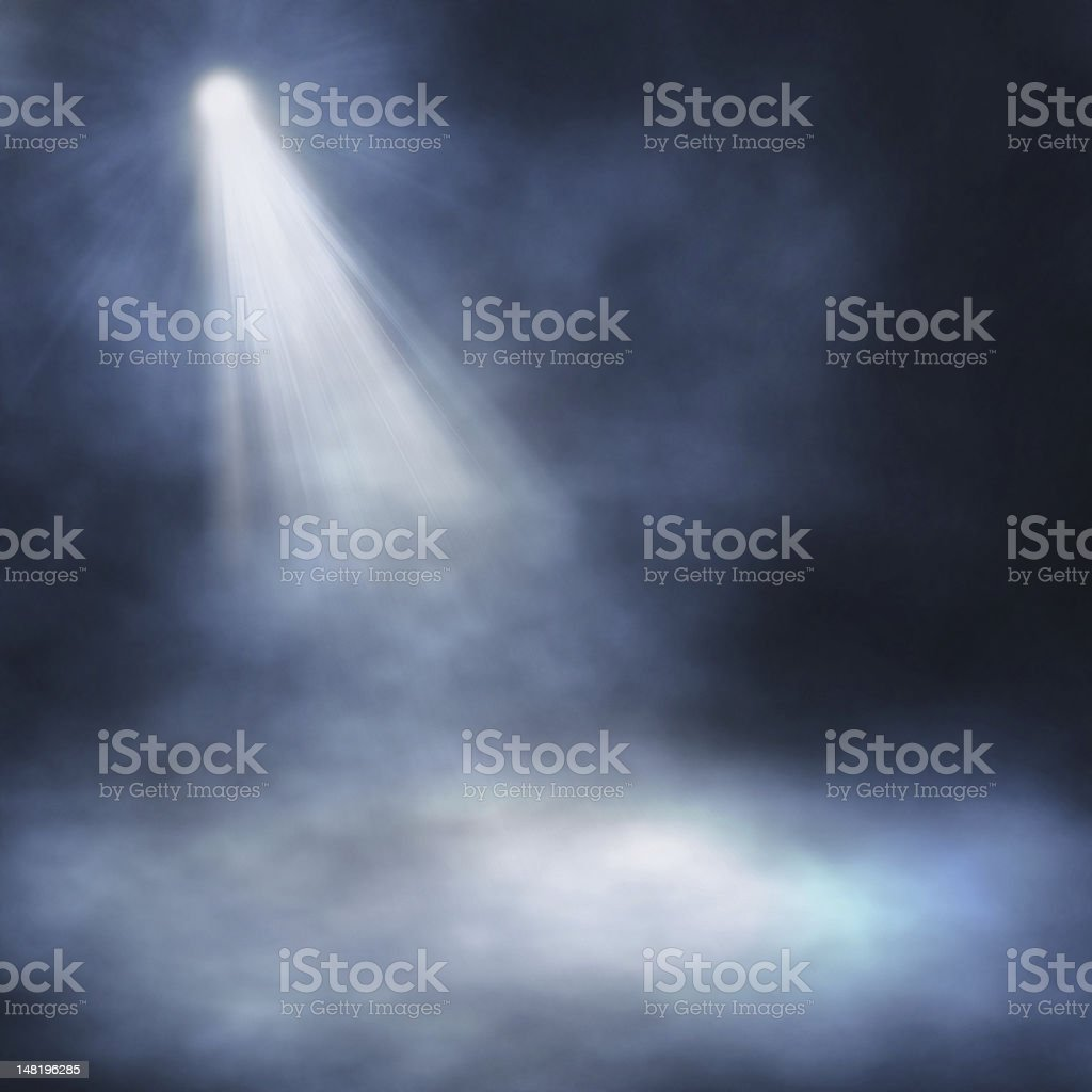 Beams of light through stage fog stock photo