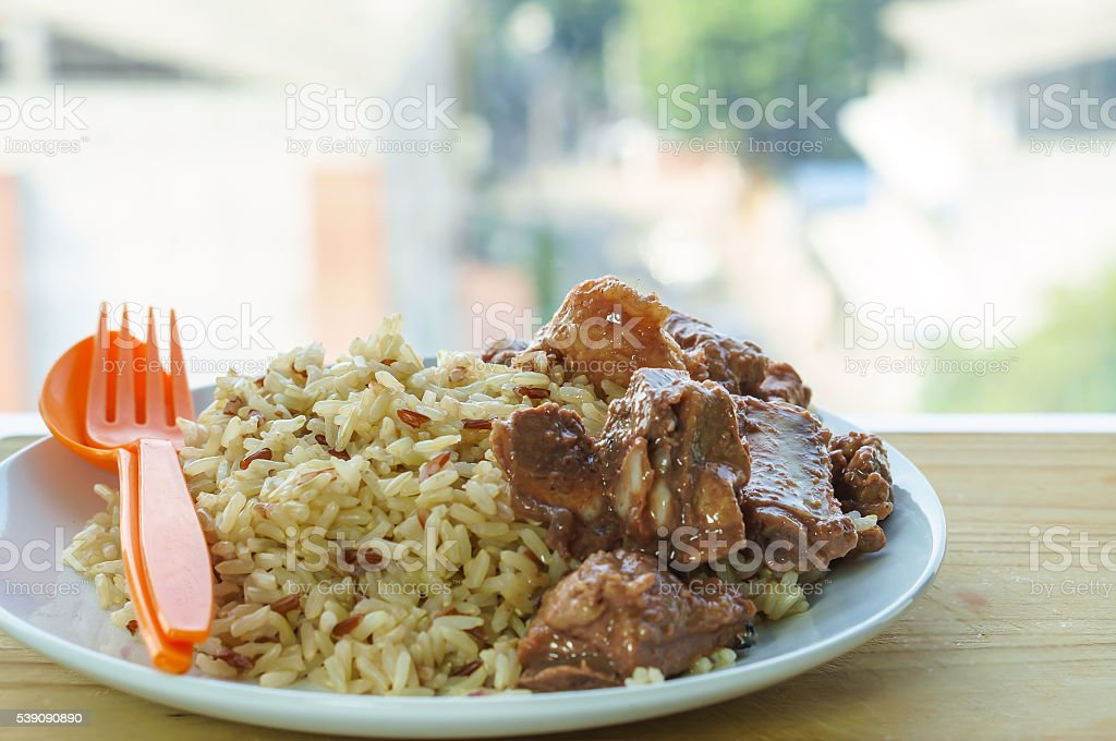 Bean curd cooked pork ribs with steamed rice stock photo
