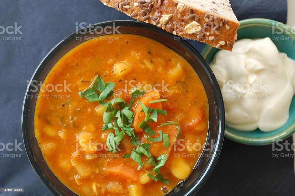 bean soup, bread and sour cream stock photo