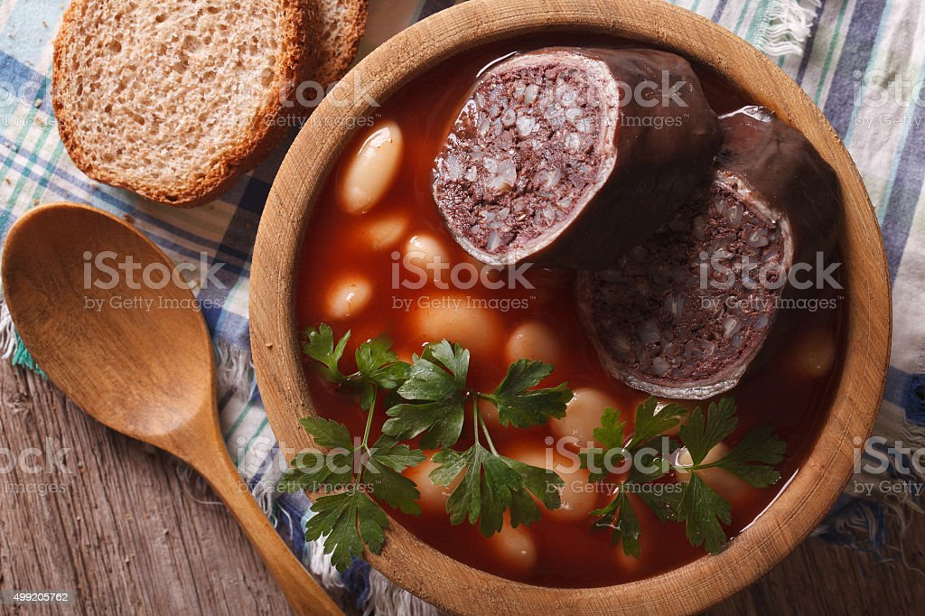 Bean soup with sausage morcilla closeup. horizontal top view stock photo