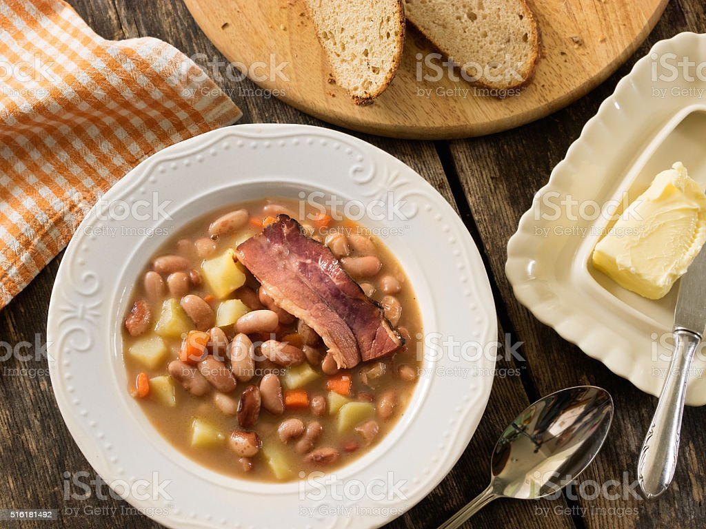 Bean soup with smoked bacon royalty-free stock photo