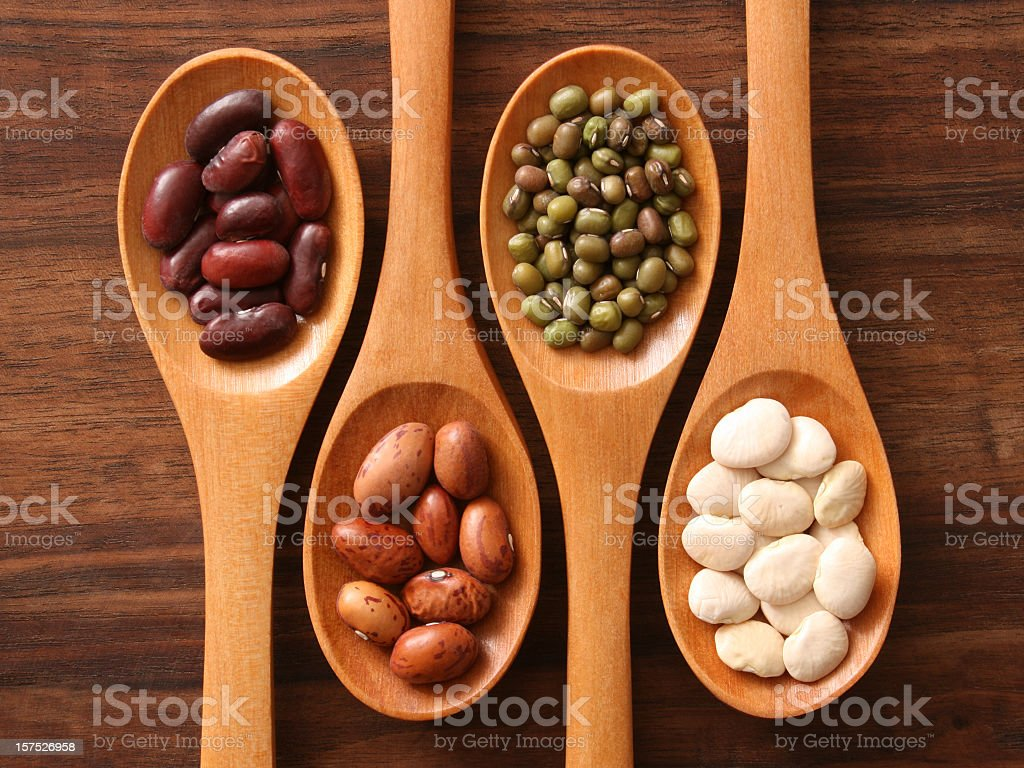 Beans and spoons stock photo