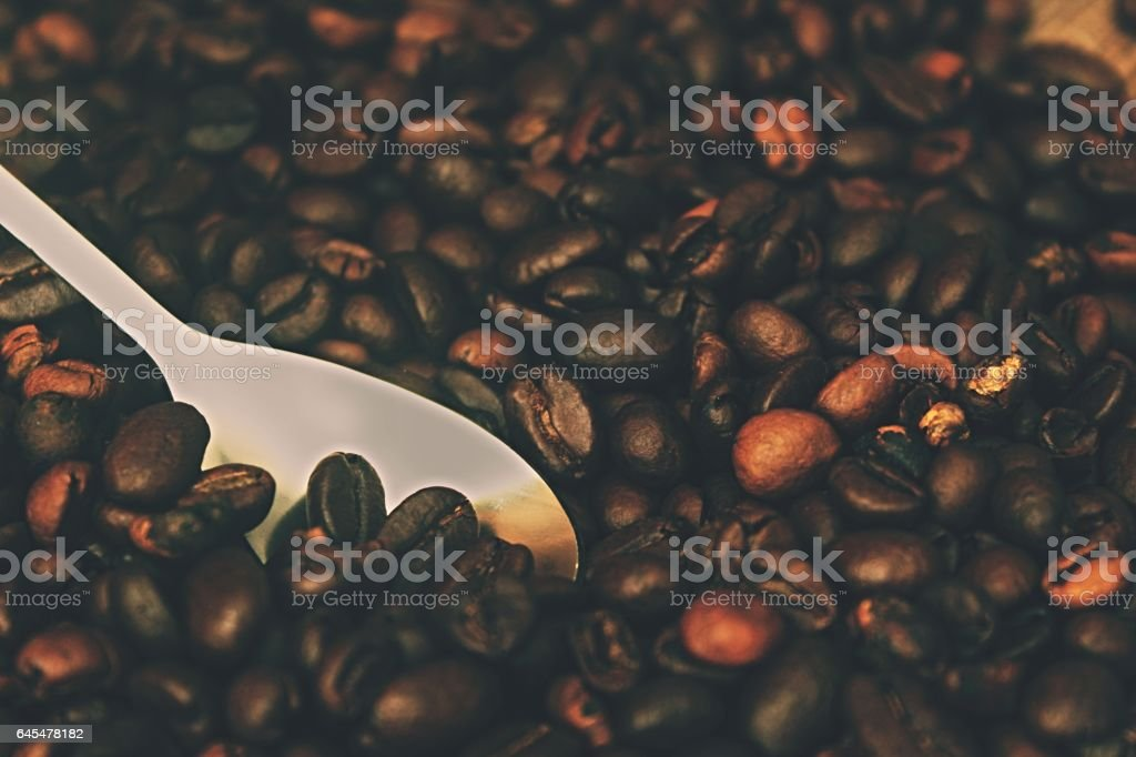 Beans coffe with spoon stock photo