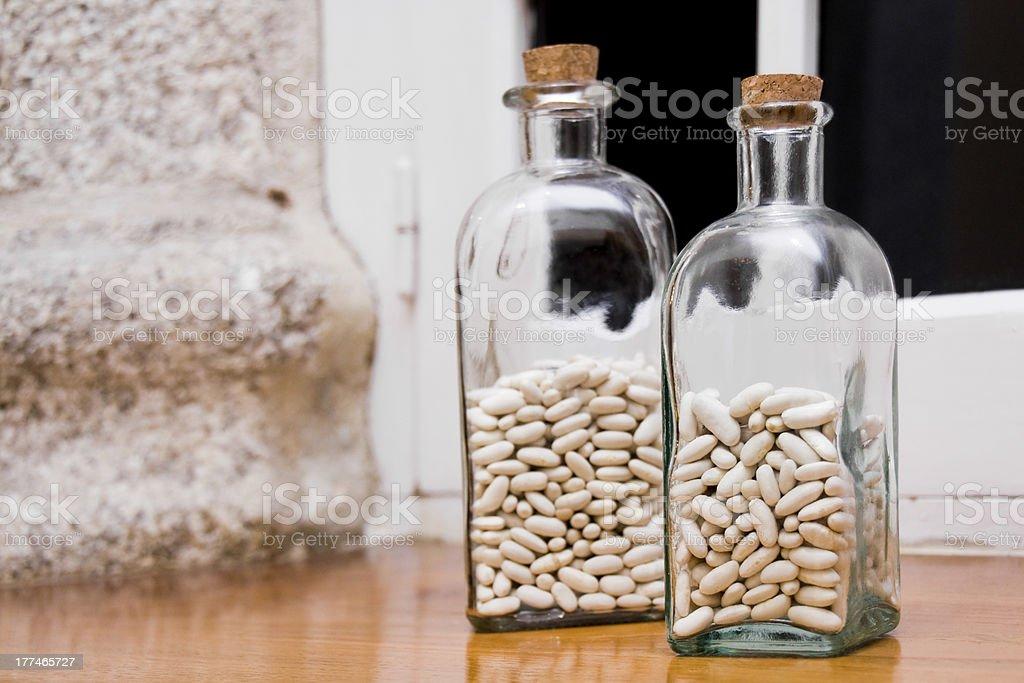 Beans in glass bottles. stock photo