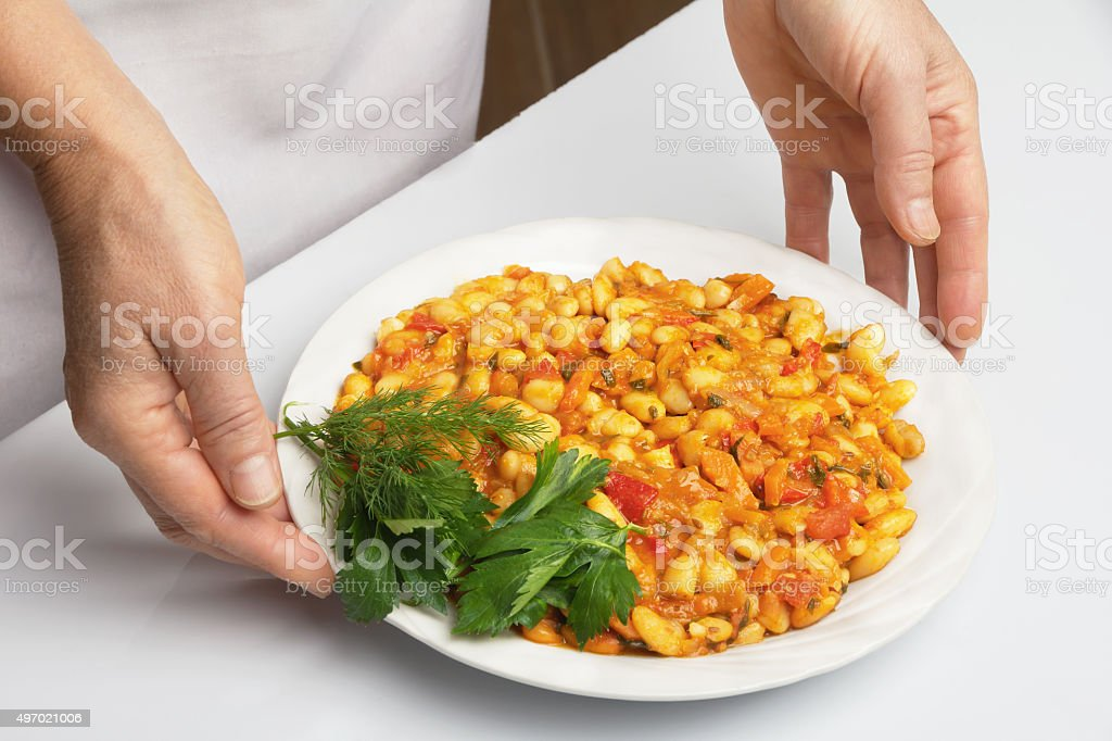 Beans stewed with vegetables stock photo