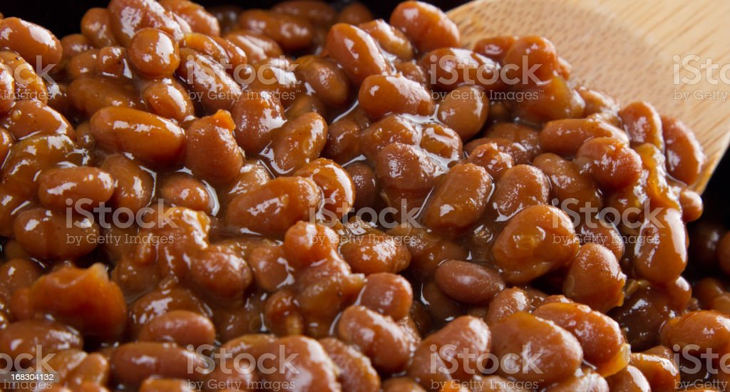 Beans with a wooden spoon stock photo