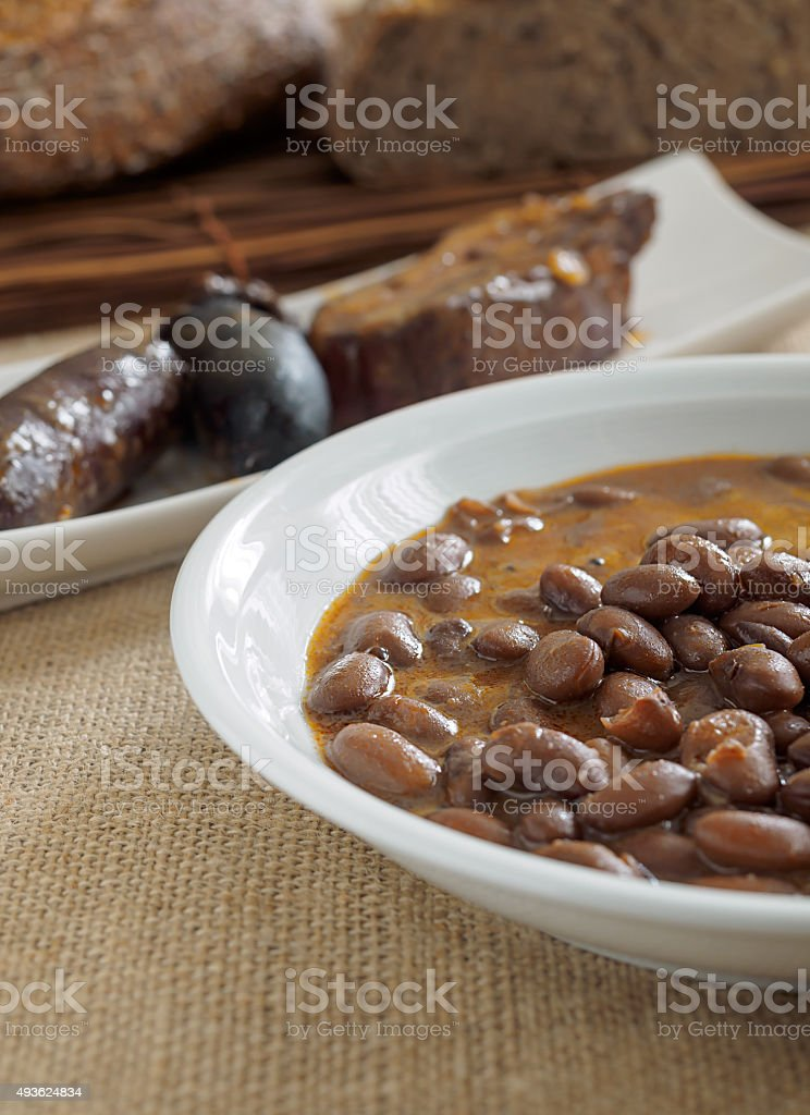 Beans with sausage and black pudding stock photo