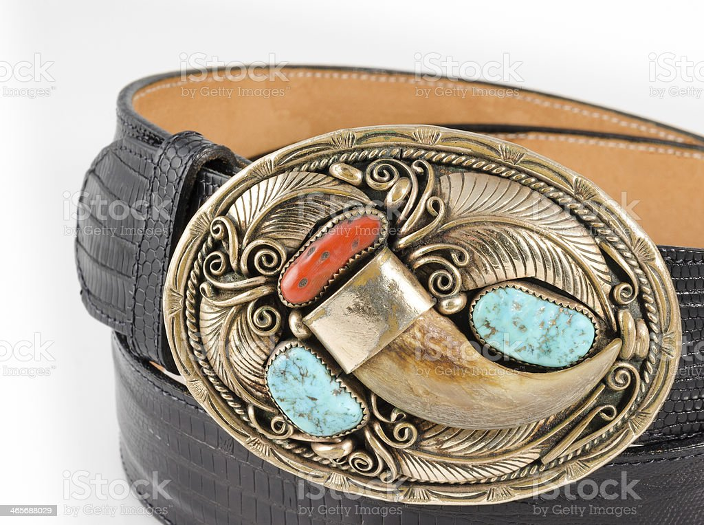 Bear Claw and Turquoise Belt Buckle. stock photo