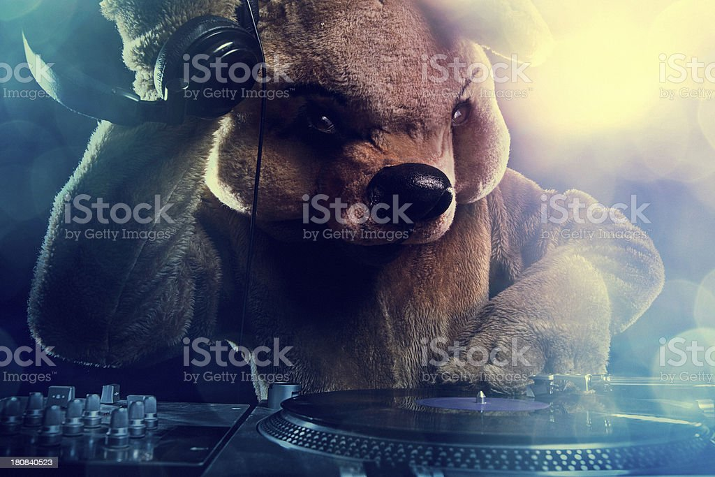 Bear Costume DJ with Turntable and Headphones stock photo