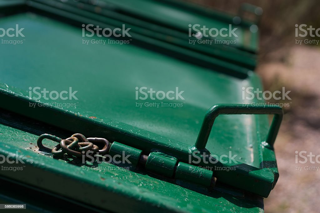 Bear Proof Trash Dumpster Mechanism with Chain stock photo