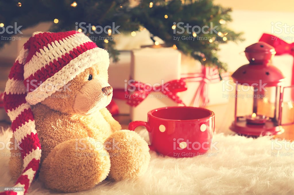 Bear with Christmas gift boxes at night stock photo