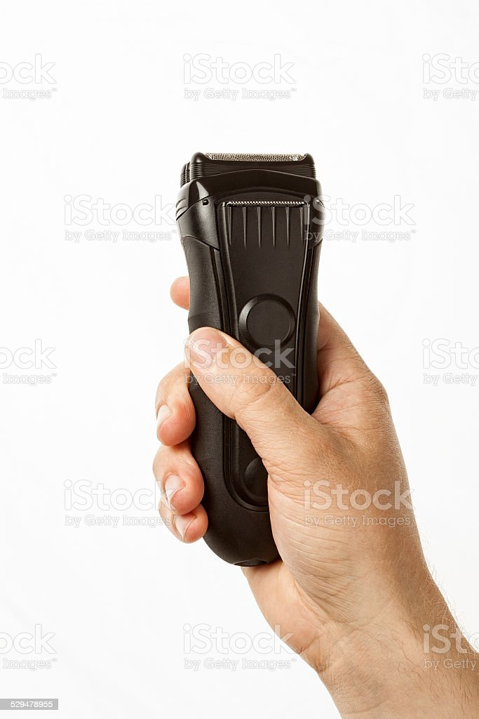 beard clipper in hand stock photo