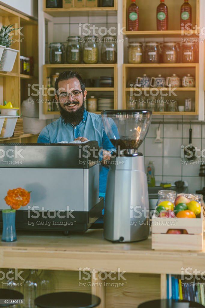 Beard Man Working In His Cafe stock photo