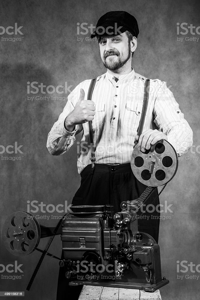 beard projectionist man going thumb up stock photo