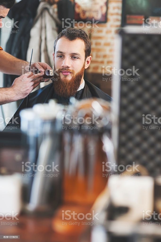 Beard trim at a Barber Shop stock photo