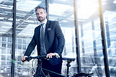 bearded business man with bicycle in Berlin City