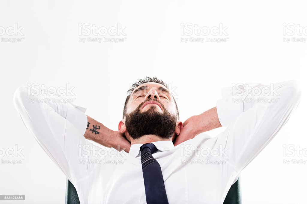 bearded businessman relaxed on chair stock photo