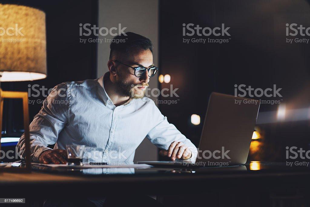 Bearded businessman wearing white shirt working on modern loft office stock photo