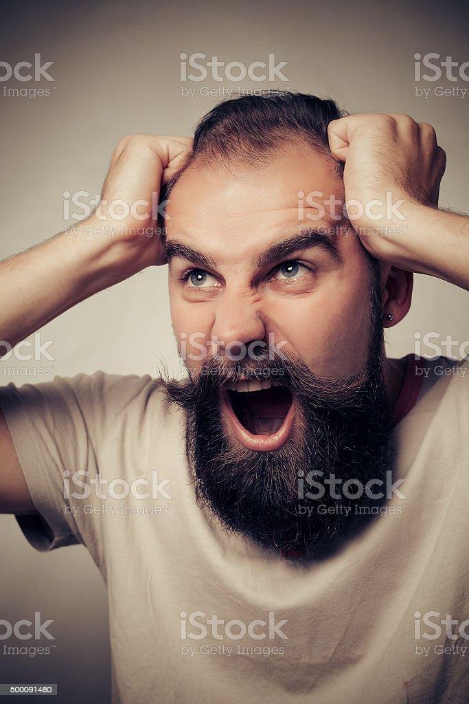 bearded guy surprised stock photo