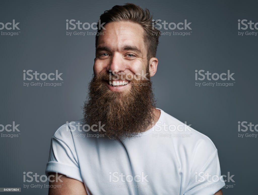 Bearded handsome man with big smile stock photo