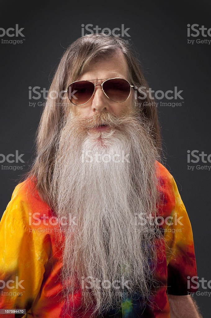 bearded hippie man w/sunglasses and tie-dye shirt/isolated stock photo