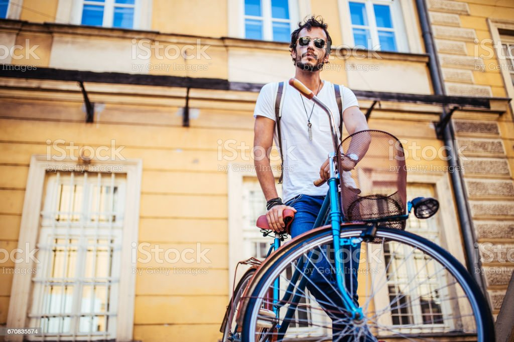 Bearded hipster with a bicycle stock photo