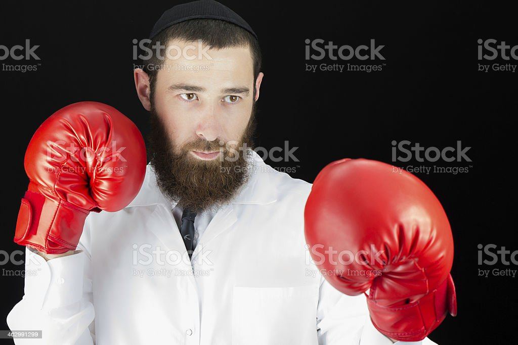 Bearded Jewish Doctor Wearing Boxing Gloves stock photo