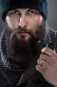 Bearded man dressed like a sailor.