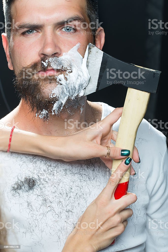 Bearded man having shaved stock photo