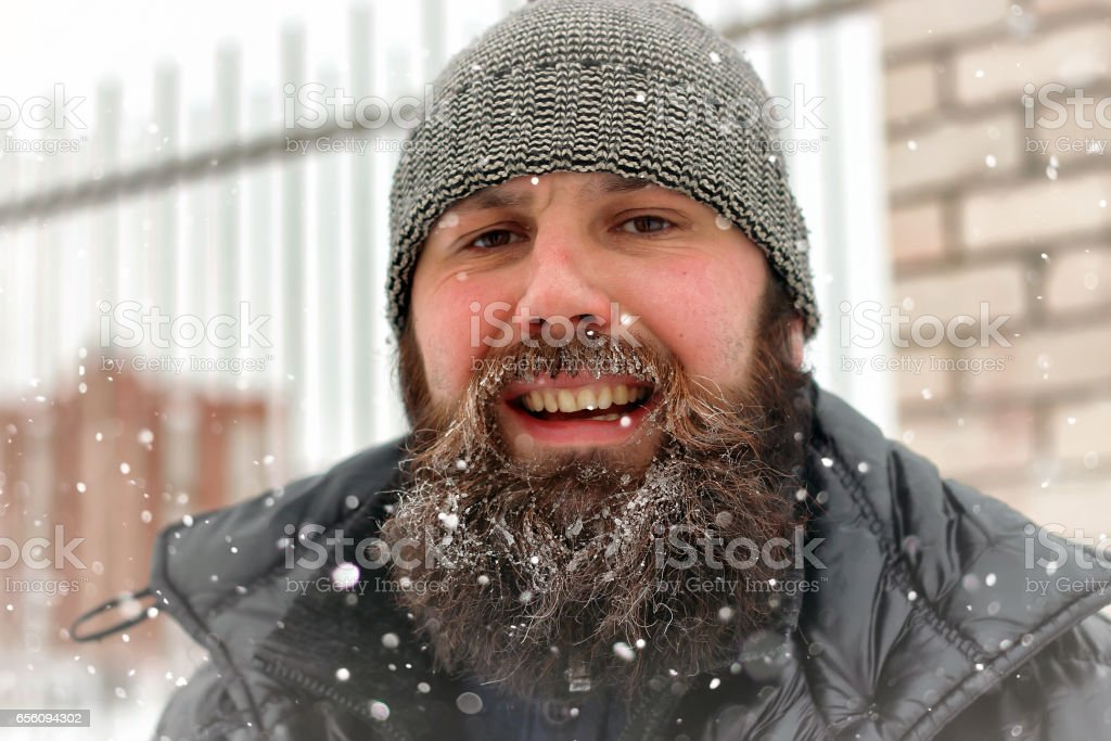 bearded man ice snow winter stock photo