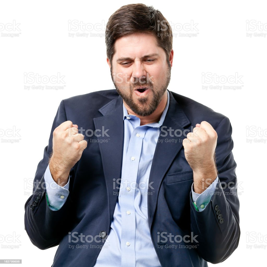 Bearded man in a suit doing the fist pump stock photo