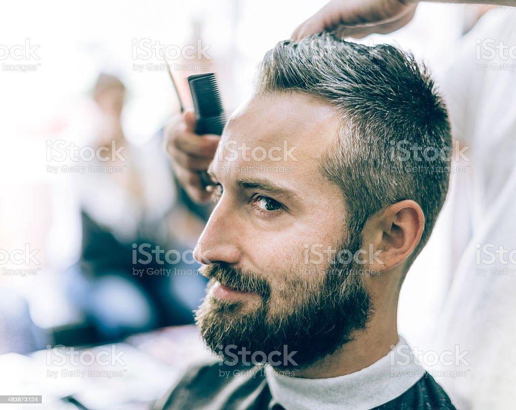 bearded man in barber shop stock photo