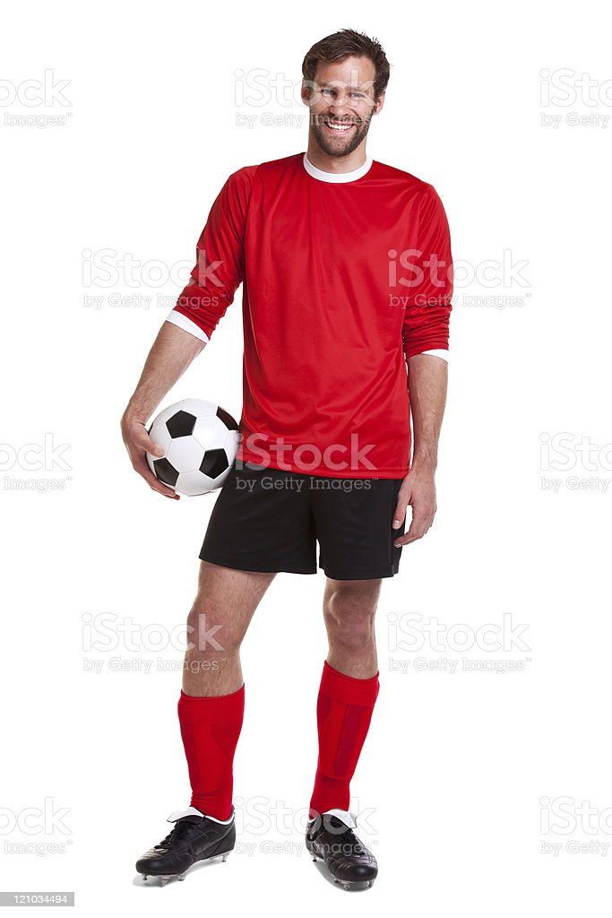 Bearded man in soccer shorts holding a soccer ball royalty-free stock photo