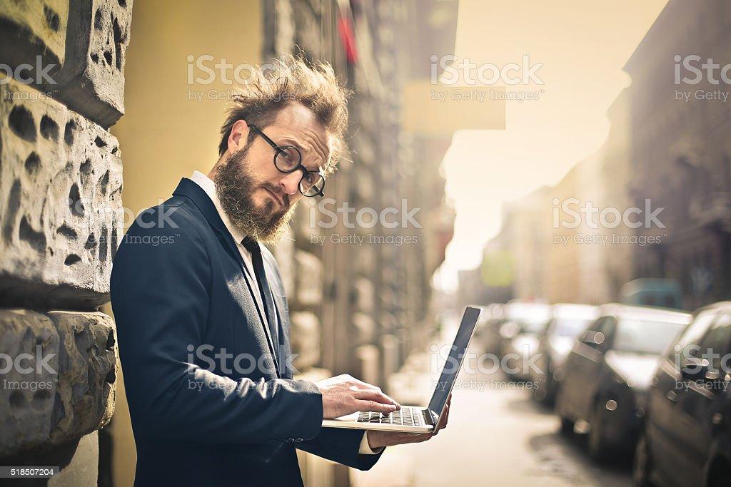 Bearded man on laptop stock photo