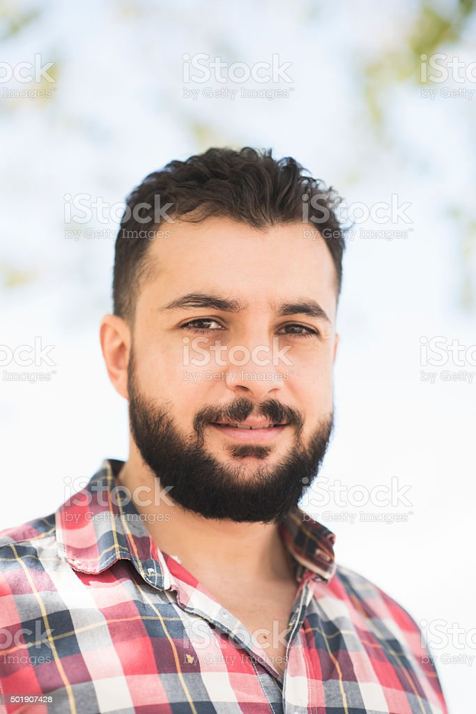 Bearded man posing stock photo