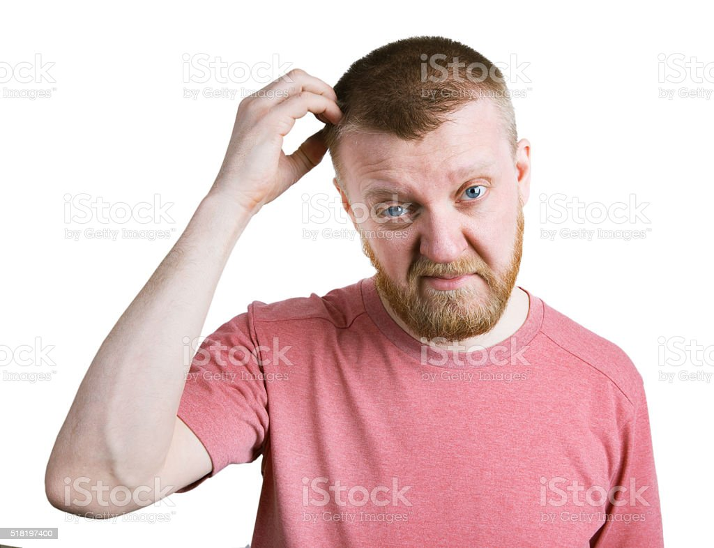 Bearded man scratches his head hair stock photo