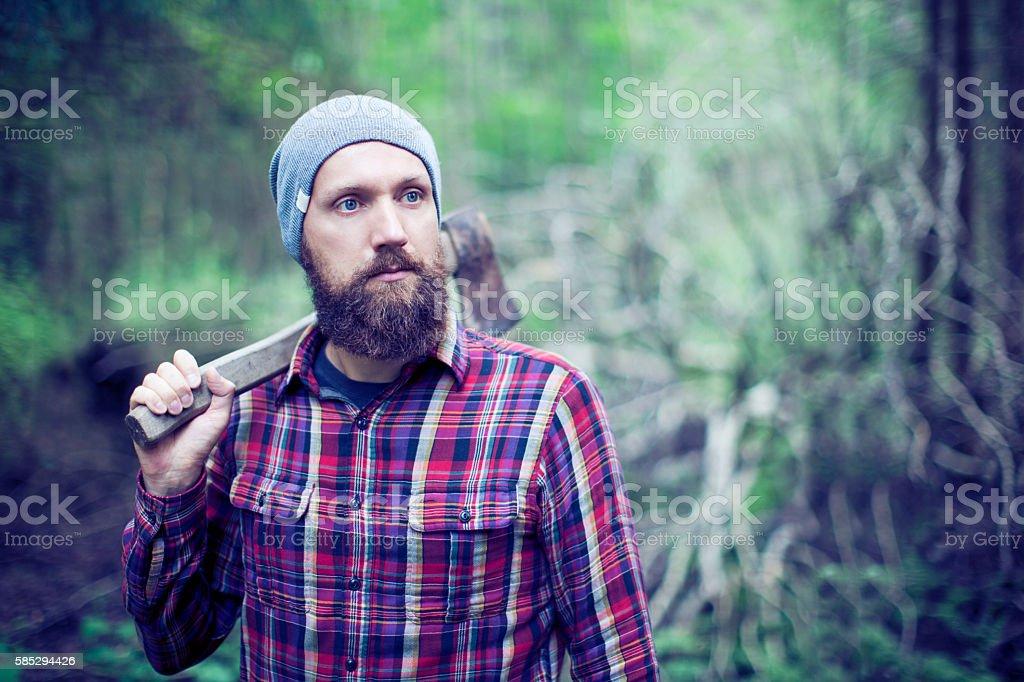 Bearded man with axe stock photo