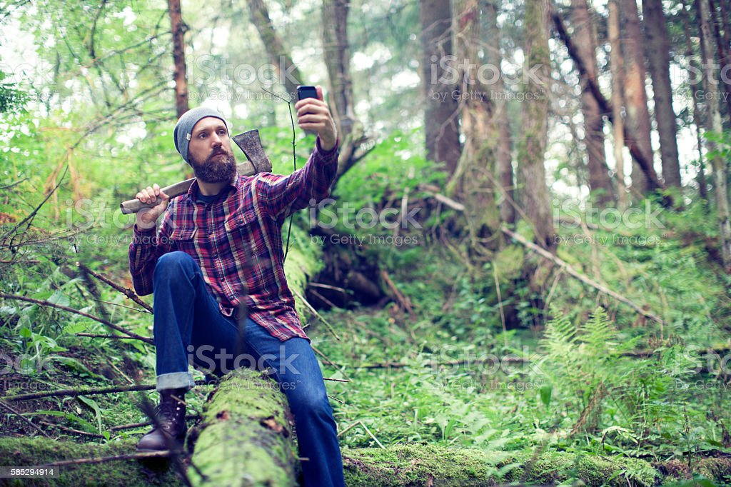 Bearded man with axe stock photo