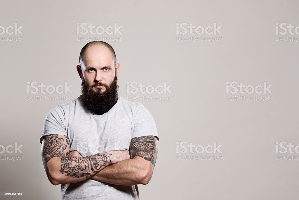 Bearded man with crossed arms stock photo