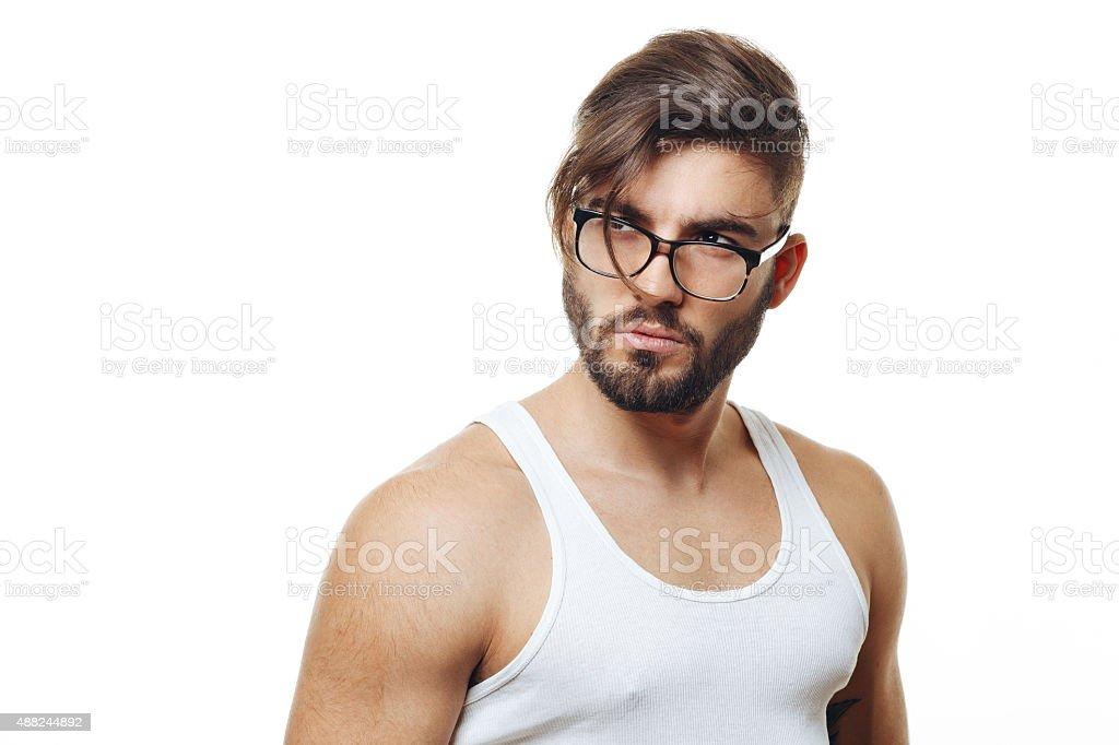Bearded man with eyeglasses posing in the studio stock photo