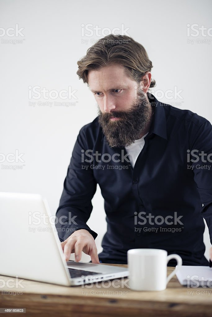 bearded Man working at desk royalty-free stock photo