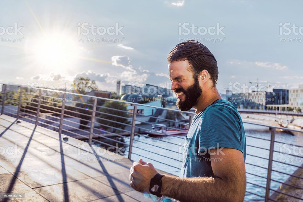 bearded sportsman fighting running on berlin bridge stock photo