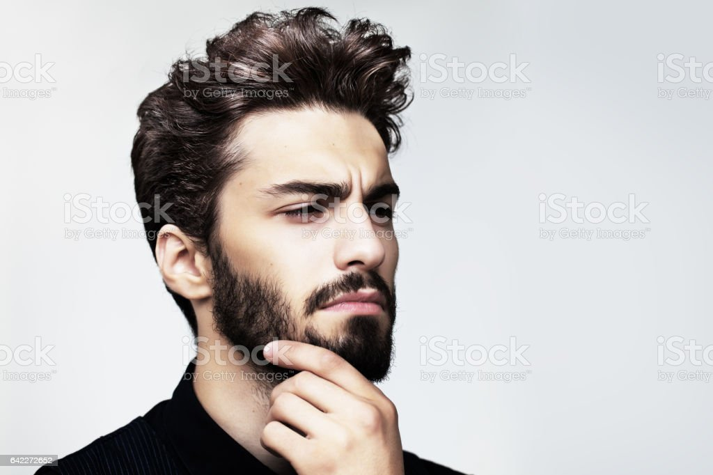 Bearded stylish man posing outdoors stock photo